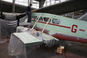 Dragon Rapide receiving its Lancashire Aircraft Corporation paint scheme