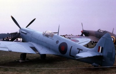 Supermarine Spitfire Reconnaissance model with a fighter model in background, showing differences in color scheme and canopies.