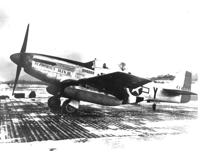 """Chuck Yeager's P-51, """"Glamorous Glen III"""" with external fuel tanks mounted and sporting 12 kill flags."""