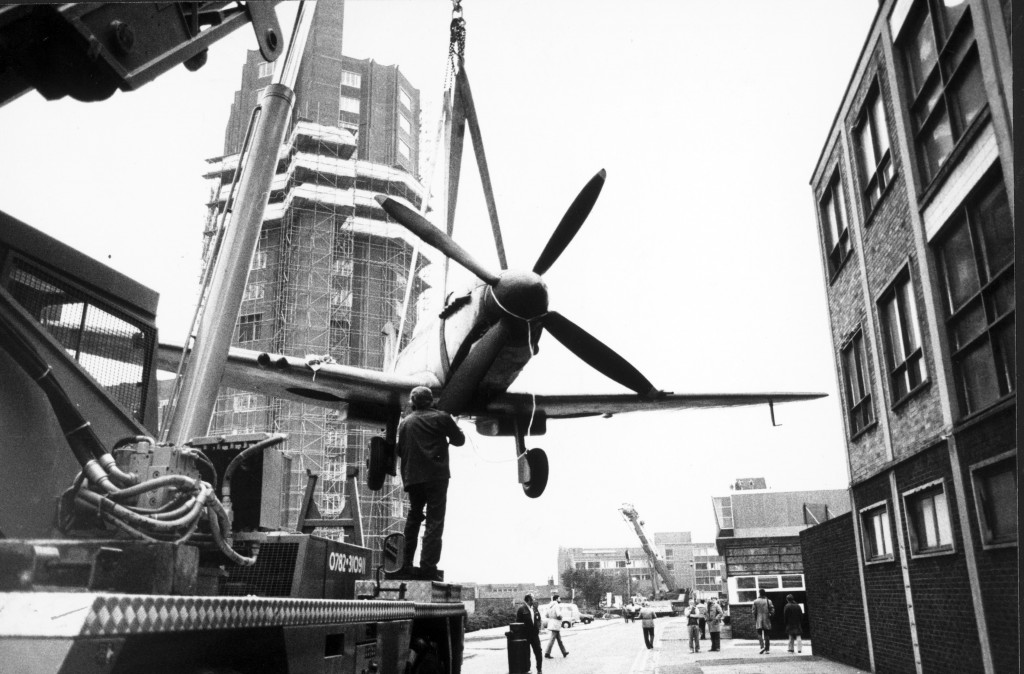Spitfire XVI being lowered into its new home in October of 1985. (photo credit: Martin Tideswell)