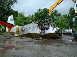 Aluminum fuselage no match for the attention of demolition machine. (Image Credit: Museo dell'Aria Castello di San Pelagio)