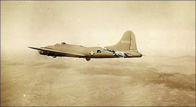 "Stricken B-17 ""All American"" miraculously flying after collision with a German fighter, photographed by the crew of another bomber in her formation."
