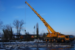 Crane brought in to lift Albatross 15-14 to an apron for it's planned disassembly last February. (Image Credit: Claudio Toselli)