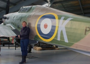 WOW Volunteers Manager Mo Schofield with Hawker Hurricane Replica (Image Credit : WOW)