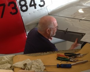 CAF Dixie Wing's Maintenance Officer works on Red Nose's elevator trim tabs. (Image Credit: CAF Dixie Wing)