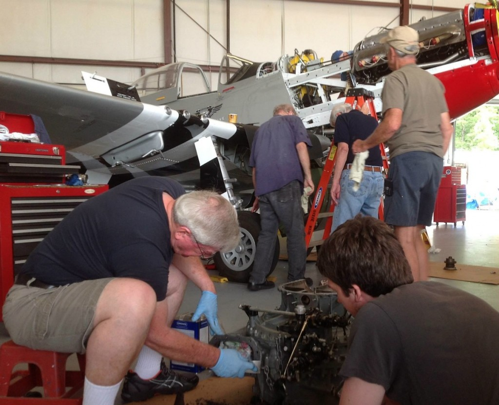 "Open nose surgery. Members of CAF Dixie Wing pitch in to make repairs to their P-51-D ""Red Nose"" (Image Credit: CAF Dixie Wing)"