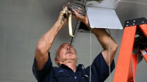 Weeks at work securing the aileron cables freed from the outboard wing panels (Image Credit: Fantasy of Flight)