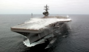 USS Ronald Reagan (CVN 76) captured during a test of its flight deck firefighting/wash-down system, mandated on all carriers in the wake of the Forrestal fire (Image Source: US Navy)