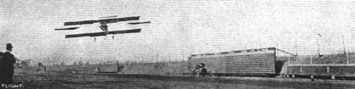 C. K. Hamilton on his biplane, racing Kjelson on an S.P.O. car at Atlanta Speedway in Atlanta, Georgia.