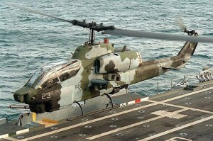 USMC Bell AH-1W Super Cobra attack helicopter taking off from an amphibious assault ship. (Image Credit: USMC)