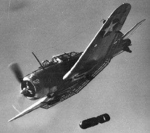 Iconic shot of a SBD Dauntless, dive brakes extended and dropping a bomb. (Image Credit: US Navy)