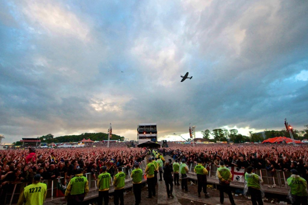 Spitfire TE311 of the RAF's Battle of Britain Memorial Flight performing a flyover for the crowd during Iron Maiden's June 15th concert at Donington Park, UK.  (Image credit: Iron Maiden)