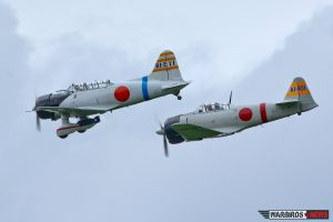 The Japanese replicas: Ken Laird's Aichi D3A VAL and Douglas Jackson's Mitsubishi A6M2 Zero. (Image Credit: Tom Pawlesh)