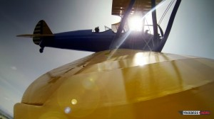 GoPro attached to the right wing tip of the Stearman piloted by Stefano Landi  provides dramatic view during flight. (Image Credit: Luckyplane.it)