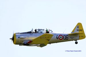 il Tricolore is waved from the rear seat of the ex-Italian Air Force T-6 Texan.  (Image Credit: Paolo Franzini)
