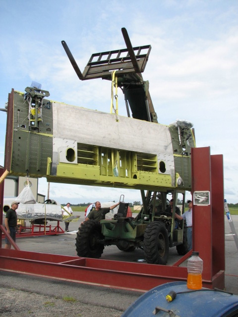 After 2.5 years, the center section finally comes out of its fixture. (Image Credit: XP-82 Restoration Project)