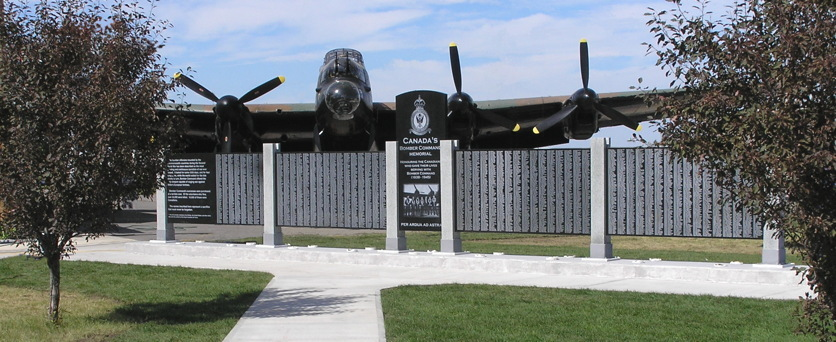 The Lancaster that started the museum, with the museum's nationally recognized Bomber Command Memorial that lists the 10,659 Canadians that gave their lives serving n the Bomber command. (Image Credit Bomber Command Museum of Canada)