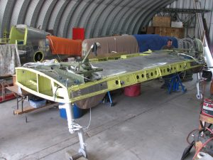Center section, now horizontal and supported on its gear. (Image Credit: XP-82 Restoration Project)