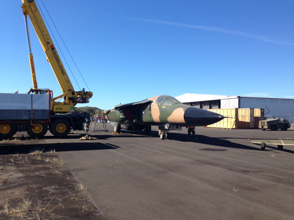 F-111C A8-147 offloaded after its overland arrival at the Evans Head Memorial Aerodrome. (Image Credit: EHMAHAA)