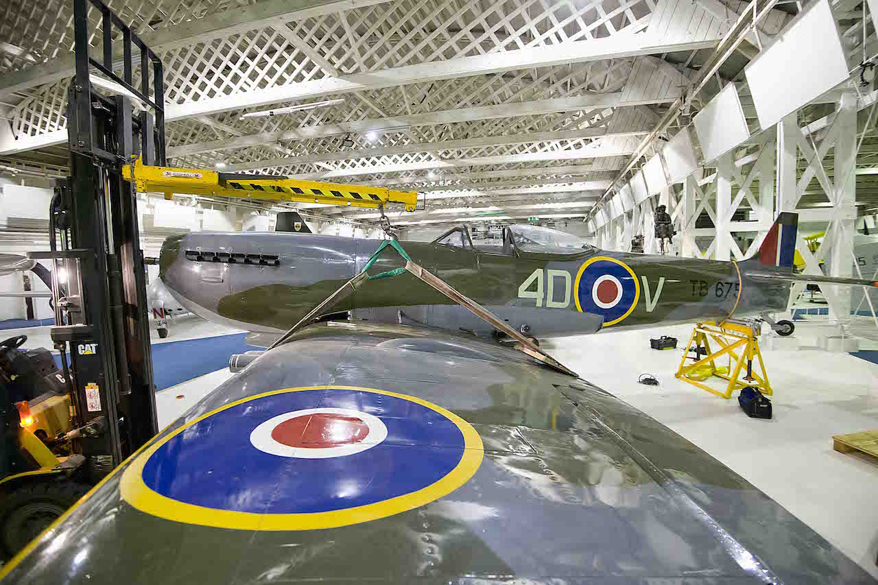 Spitfire Mk16 assembly inside the museum ('©Trustees of the Royal Air Force Museum')