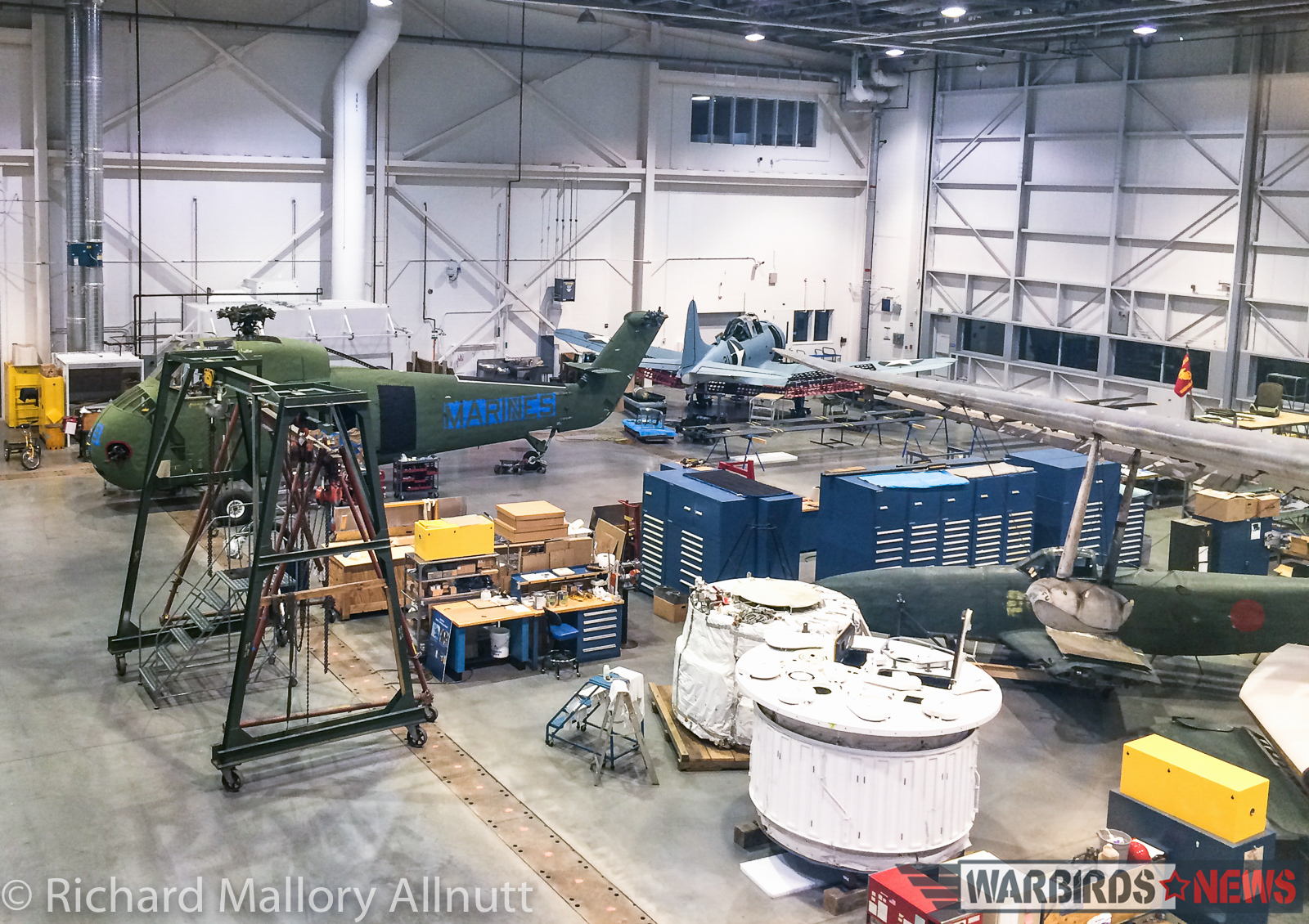 The National Museum of the United States Marine Corps' SBD Dauntless and H-34 can be seen in the distance. The H-34 was airworthy, until fairly recently, but couldn't find a buyer so the owners donated her to the Corps. She, along with the Dauntless, will soon be going on display in the main atrium of their new home. (photo by Richard Mallory Allnutt)