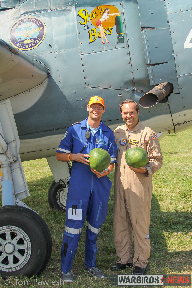 Charlie Lynch (r) in front of his TBM with Doug Marotte, showing off a pair of watermelons which would be used in the watermelon 'bomb' drop flown by Lynch in his TBM. (Photo by Tom Pawlesh)
