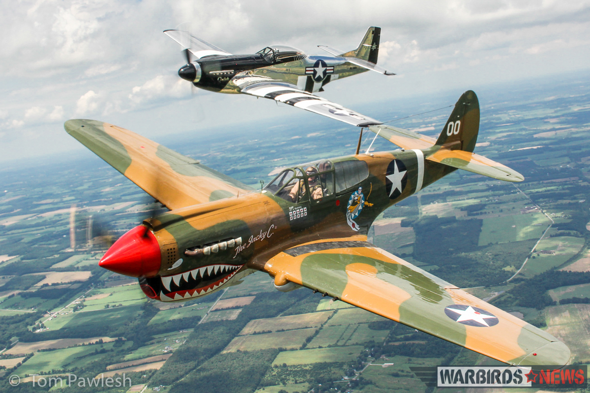 "The American Airpower Museum's P-40M 'The Jacky C."" flanked by Scott Yoak's P-51D 'Quick Silver'. (Photo by Tom Pawlesh)"