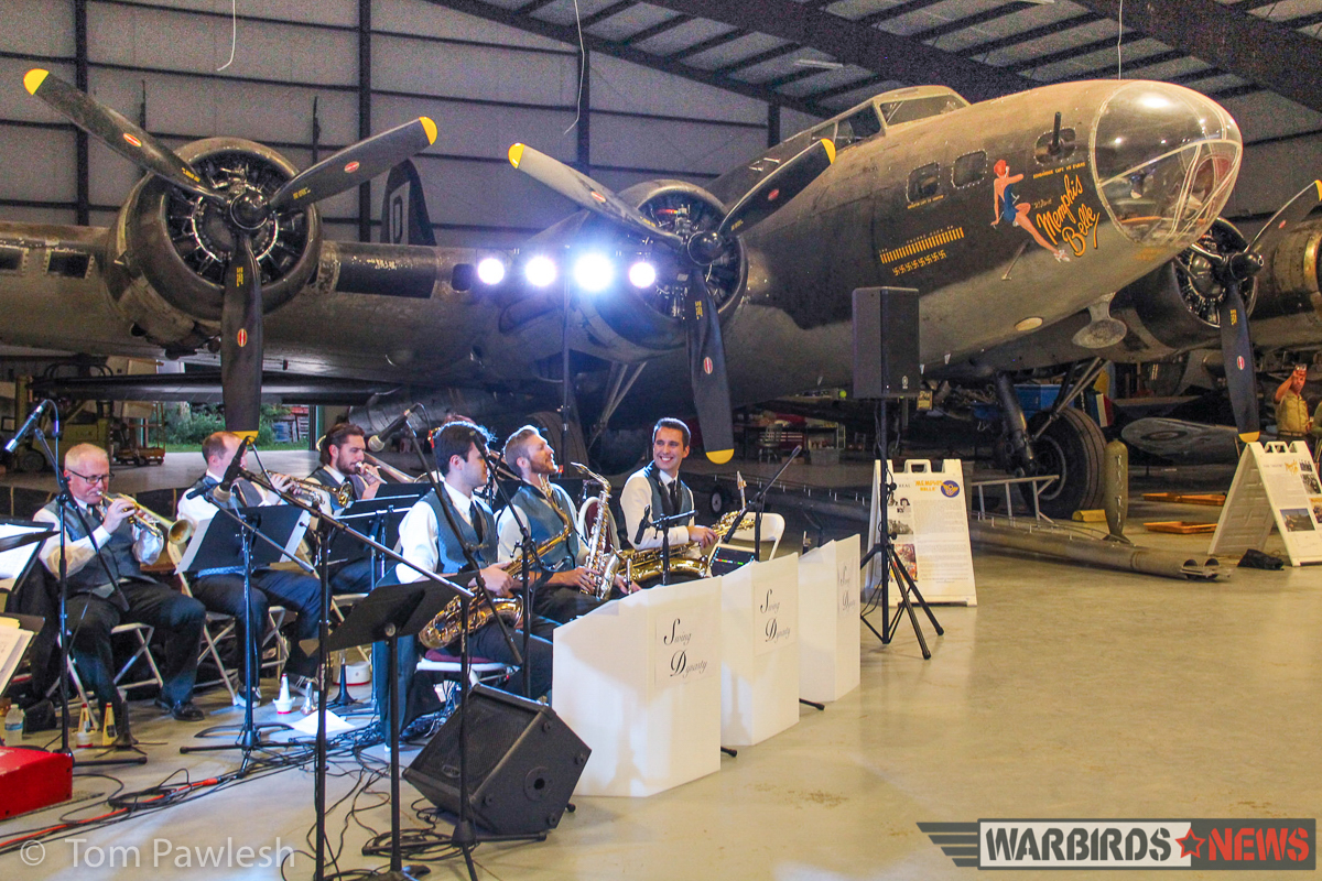 The band plays at the hangar dance with the B-17G 'The Movie Memphis Belle' in the background. (Photo by Tom Pawlesh)