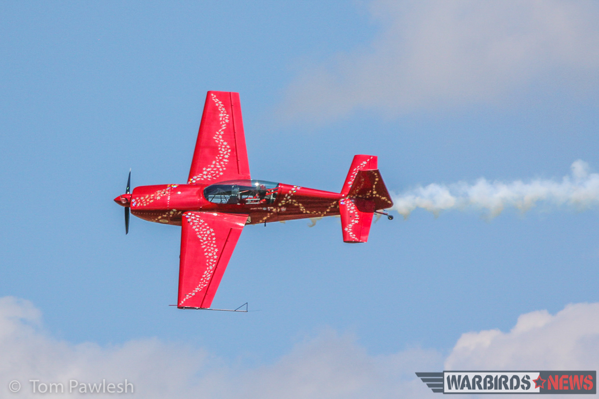 Jaquie B and her Extra 300. (Photo by Tom Pawlesh)