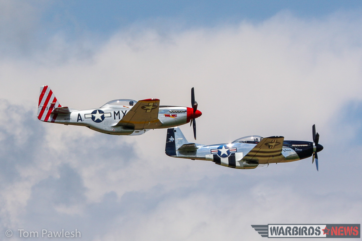 A pair of P-51s making a low, formation pass. (Photo by Tom Pawlesh)