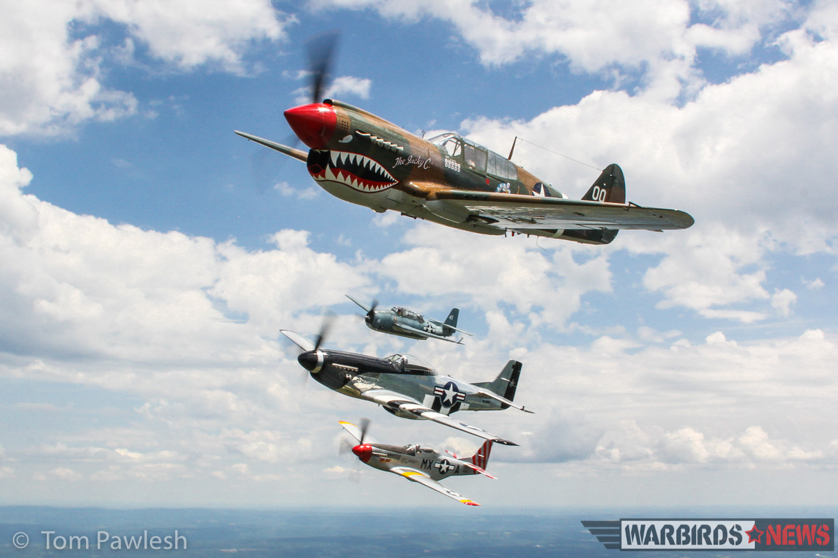 Another great air-to-air with the P-51s, P-40 and TBM. (Photo by Tom Pawlesh)