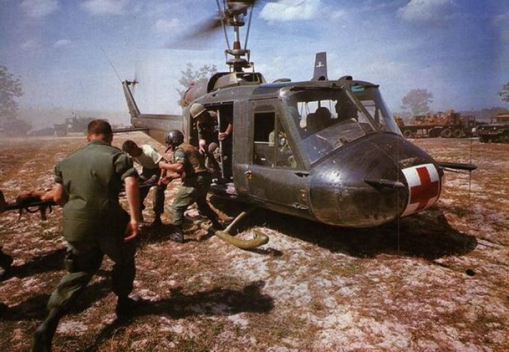 A Dustoff flight picking up wounded soldiers from the battlefield during the Viet Nam War.