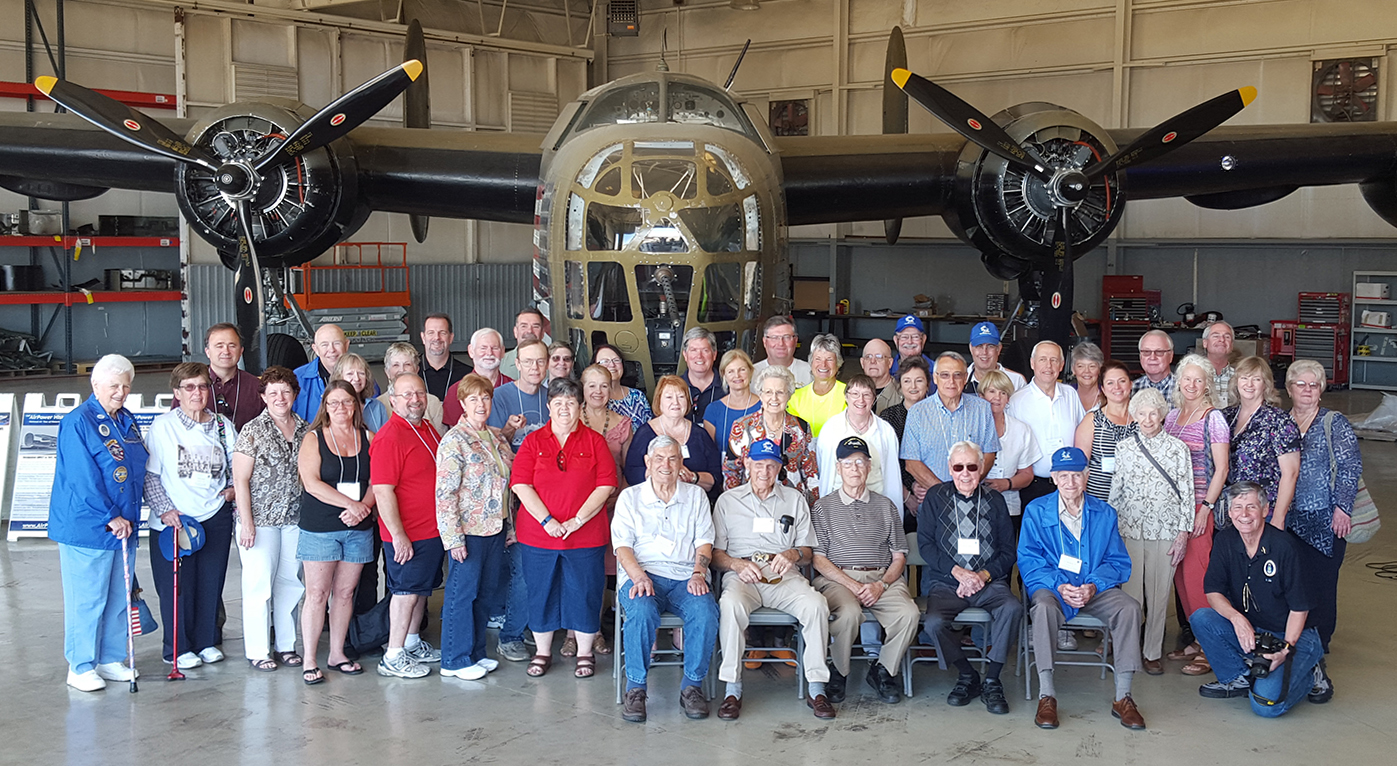 "5 World War II veterans (seated) of the 380th Bombardment Group (Heavy) pose with family members in front of the Commemorative Air Force (CAF) Consolidated B-24 Liberator ""Diamond Lil"" on Friday, Oct 16th.  Over 50 members of the 380th Bomb Group Association toured the historic bomber at the CAF National Airbase at Dallas Executive Airport in Dallas, Texas.  (Photo Credit: Konley Kelley)"