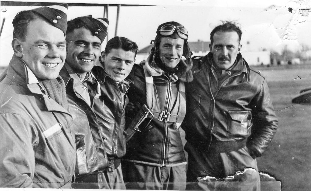 British Aviator Denis Payne (with goggles) was photographed with four of his flying mates during training in Americus at Souther Field.