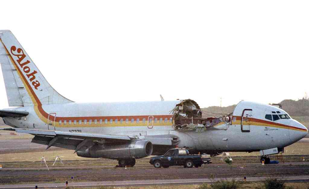 Aloha Airlines Boeing 737 (-200 Series) on the tarmac of Kahului Airport (OGG) in 1988. The major structural failure killed one flight attendant, severely injured several passengers, and caused the flight crew to make an emergency diversion and landing at OGG. [Photo Credit: Wikipedia]