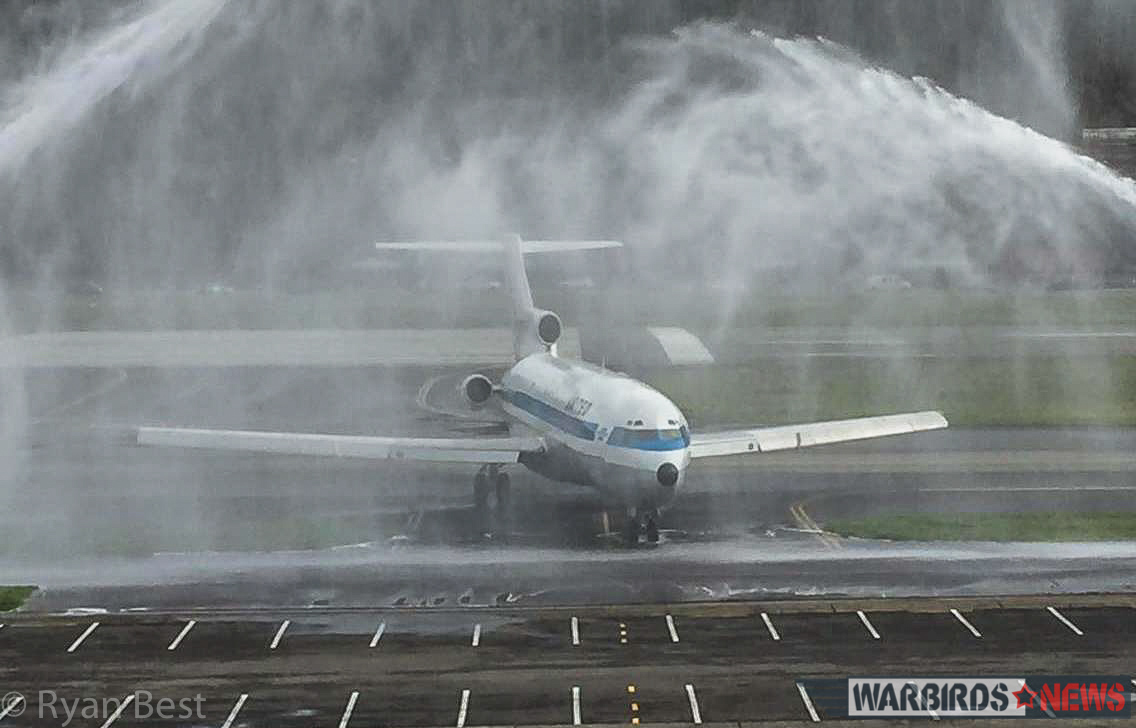 727 Prototype arriving at Boeing Field, and taxiing under the honorary firehoses. (photo by Ryan Best)
