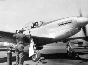 Ferry pilot Florene Watson, WAF, warms up her P-51 (Courtesy: USAF via Wilipedia)