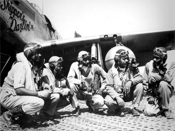 "Pilots of the 332nd Fighter Group, ""Tuskegee Airmen,"" the elite, all-African American 332nd Fighter Group at Ramitelli, Italy., from left to right, Lt. Dempsey W. Morgran, Lt. Carroll S. Woods, Lt. Robert H. Nelron, Jr., Capt. Andrew D. Turner, and Lt. Clarence P. Lester. (U.S. Air Force photo- Via Wikepedia)"