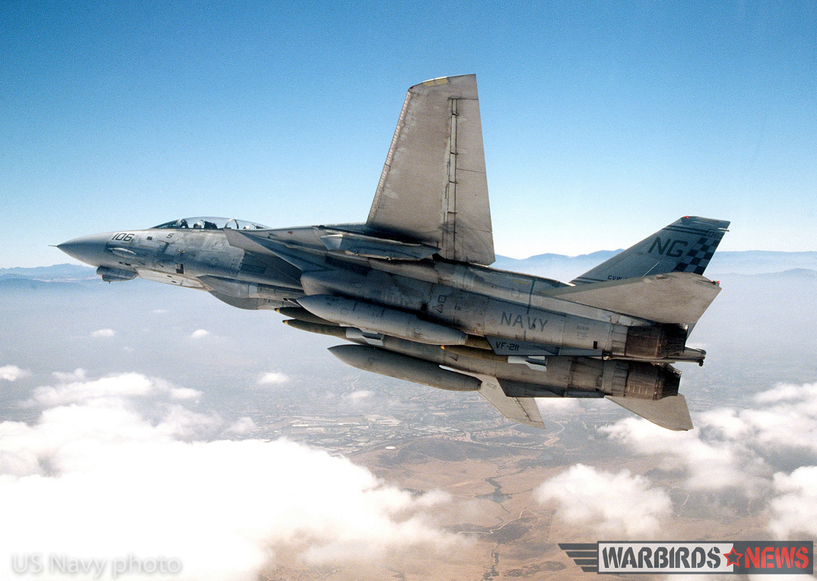 "Twenty Nine Palms, Calif. (Jul. 17, 1996) -- An F-14A ""Tomcat"" assigned to the ""Checkmates"" of Fighter Squadron Two One One (VF-211) prepares to make a bombing run at Twenty Nine Palms Marine Corps Station. The aircraft is on a routine training mission and is loaded with four MK-82 500-pound bombs. U.S. Navy photo by Photographer's Mate 1st Class Mahlon K. Miller. (RELEASED)"