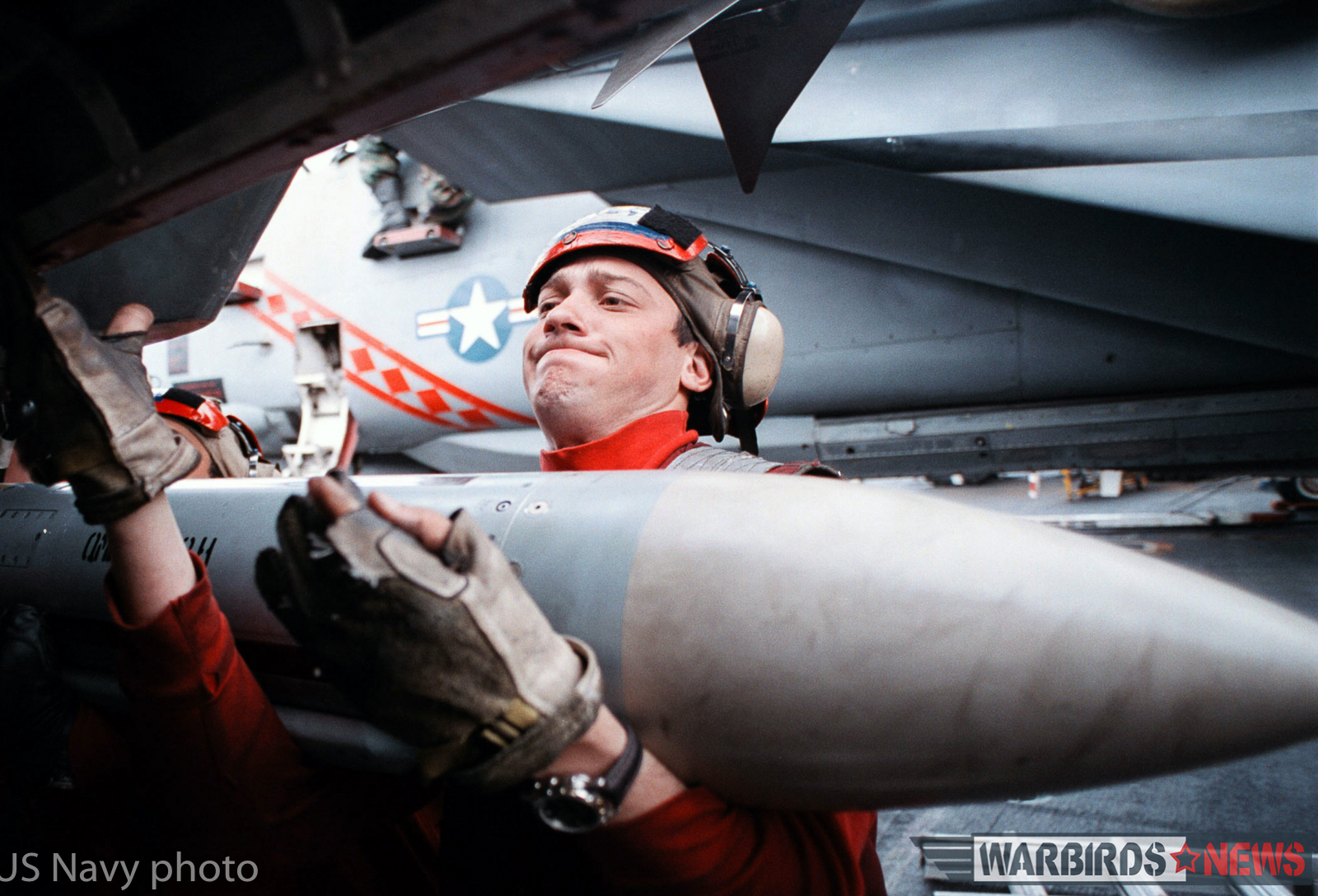 """ABOARD USS GEORGE WASHINGTON (February 21, 1998) --Aviation Ordnanceman 3rd Class Jacques Devries, from Houston, Texas, loads an AIM-7 """"Sparrow"""" medium range air-to-air missile onto an F-14B """"Tomcat"""" assigned to Fighter Squadron One Zero Two (VF-102). George Washington and its embarked Carrier Air Wing one (CVW1) are currently conducting operations in the Persian Gulf to enforce UN sanctions against Iraq. U.S. Navy photo by Photographer's Mate 3rd Class Sammy Dallal (Released) Digital Film Scan"""