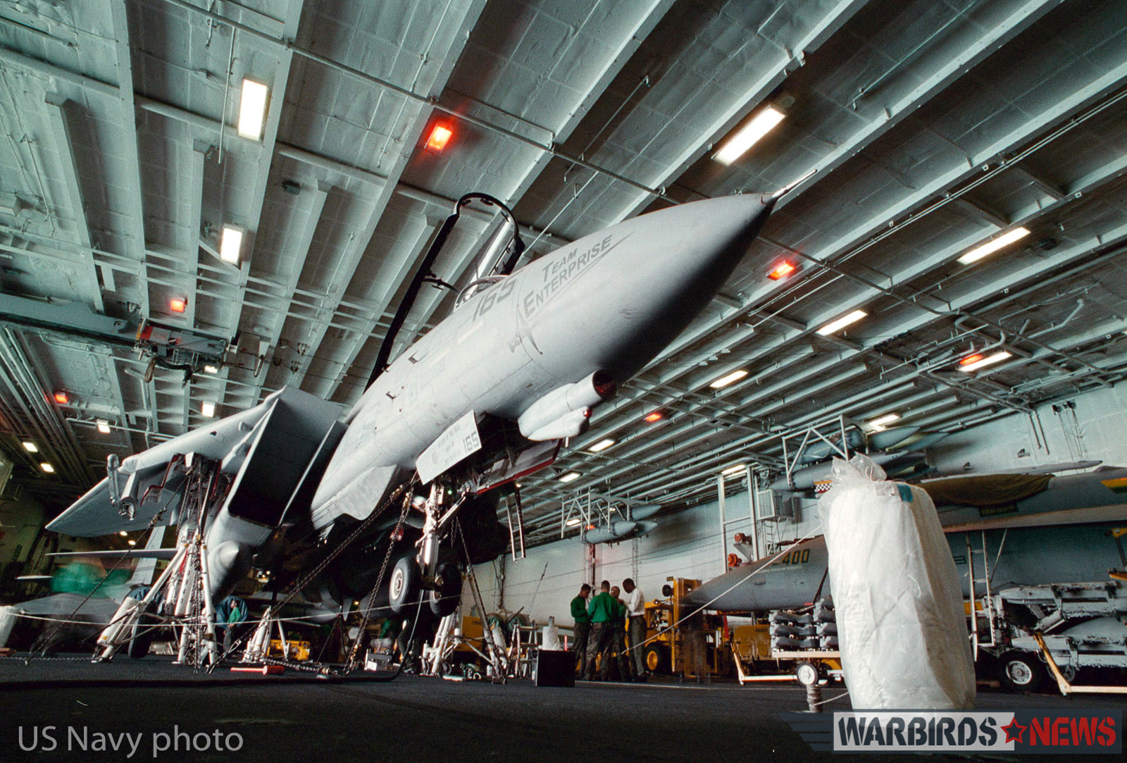 "At sea aboard USS Enterprise (CVN 65) (Nov. 6, 1998) -- An F-14 ""Tomcat"" from Fighter Squadron Thirty Two (VF-32) undergoes a check for proper operation of its landing gear. The USS Enterprise deployed to the Arabian Gulf. U.S. Navy Photo by Photographer's Mate 1st Class Nicholas D. Sherrouse. (RELEASED)"