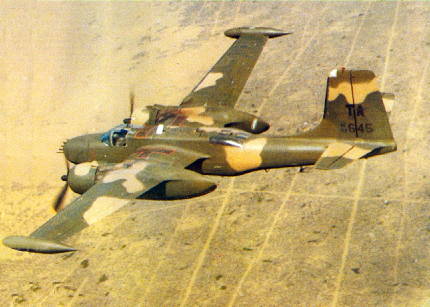 An A-26 Invader of the 609th Special Operations Squadron flying near Nakhon Phanom Royal Thai Air Base in 1969. ( Image via Wikipedia)