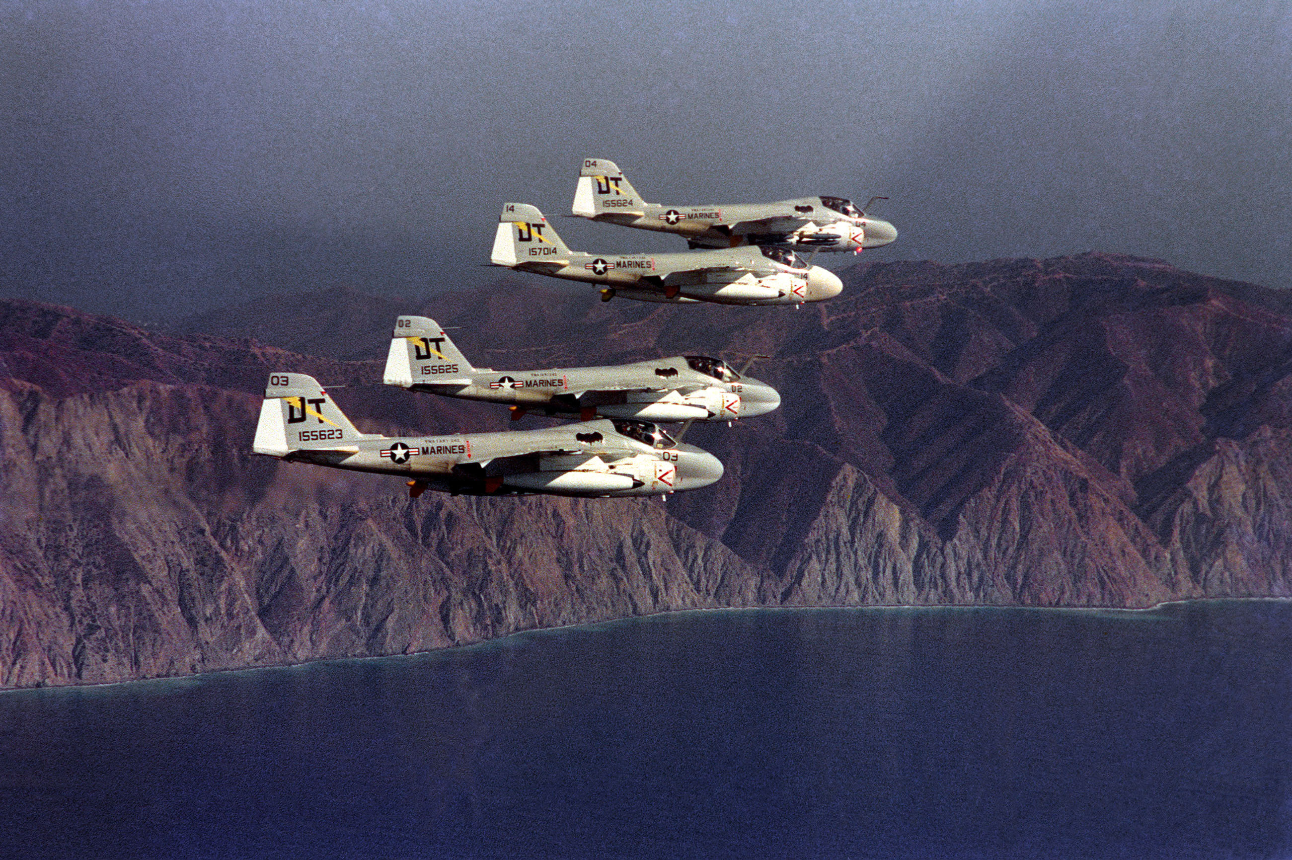 Four U.S. Marine Corps All-Weather Medium Attack Squadron 242 (VMA(AW)-242) Grumman A-6A Intruder aircraft (BuNo 155623, 155624, 155625, 157014) flying in echelon formation on 21 November 1975. (Image by Sgt. C. Quinn, USMC via Wikipedia)