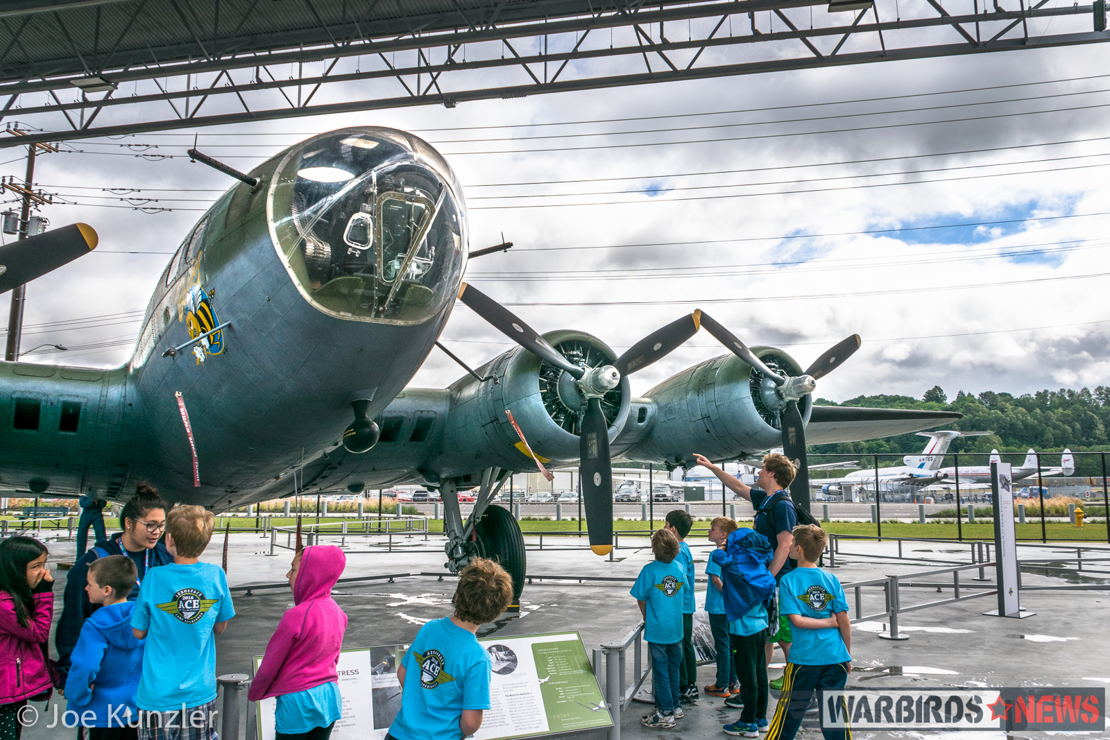 ACE Campers gaze at the Museum of Flight's Boeing B-17F Flying Fortress known as 'Boeing Bee'. (photo by Joe Kunzler)