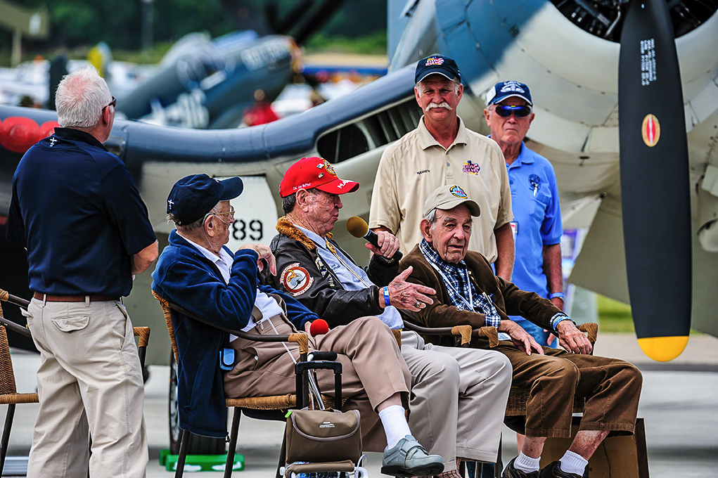 WWII veterans alongside modern warbird pilots discuss the Corsair during the Warbirds in Review session in front of TFLM's FG-1D. (photo by Jake Peterson)