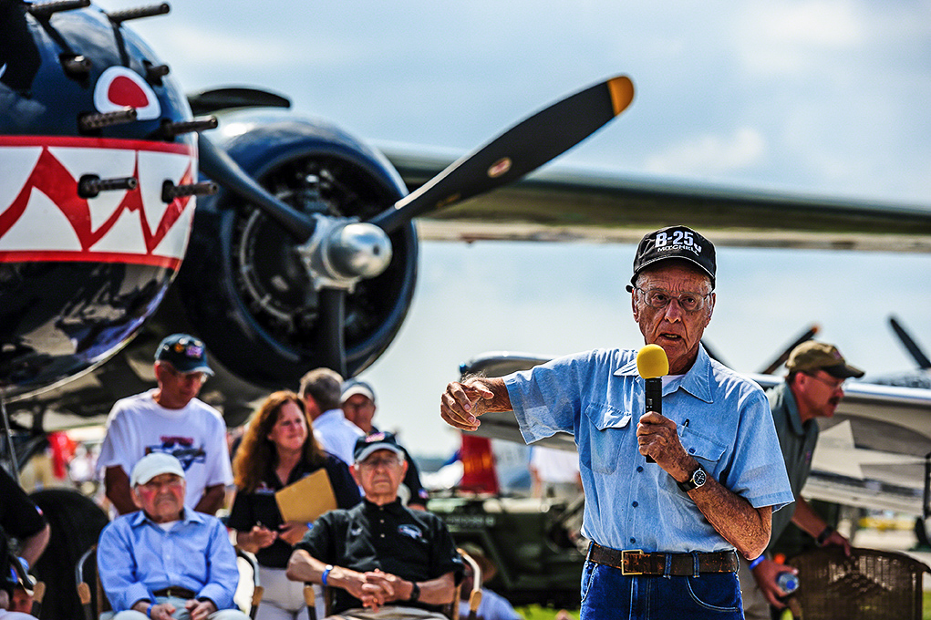 A WWII B-25 veteran describes his wartime experiences during a Warbirds in Review session at AirVenture Oshkosh while standing in front of TFLM's Mitchell Betty's Dream. (photo by Jake Peterson)
