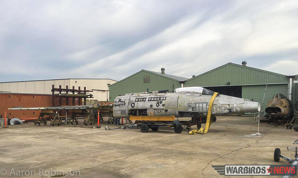 The fuselage of Super Sabre F-100D 56-2995 awaiting the attachment of her wings. Note at the extreme right you can see the fuselage of F-100D 56-2928 which has donated many parts and indeed its wings to 2995. (photo by Aaron Robinson)
