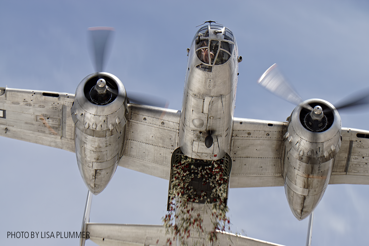 Aero Trader own B-25 piloted by Carl Scholl dropping 3000 carnations from the bomb bay. ( photo by Lisa Plummer)