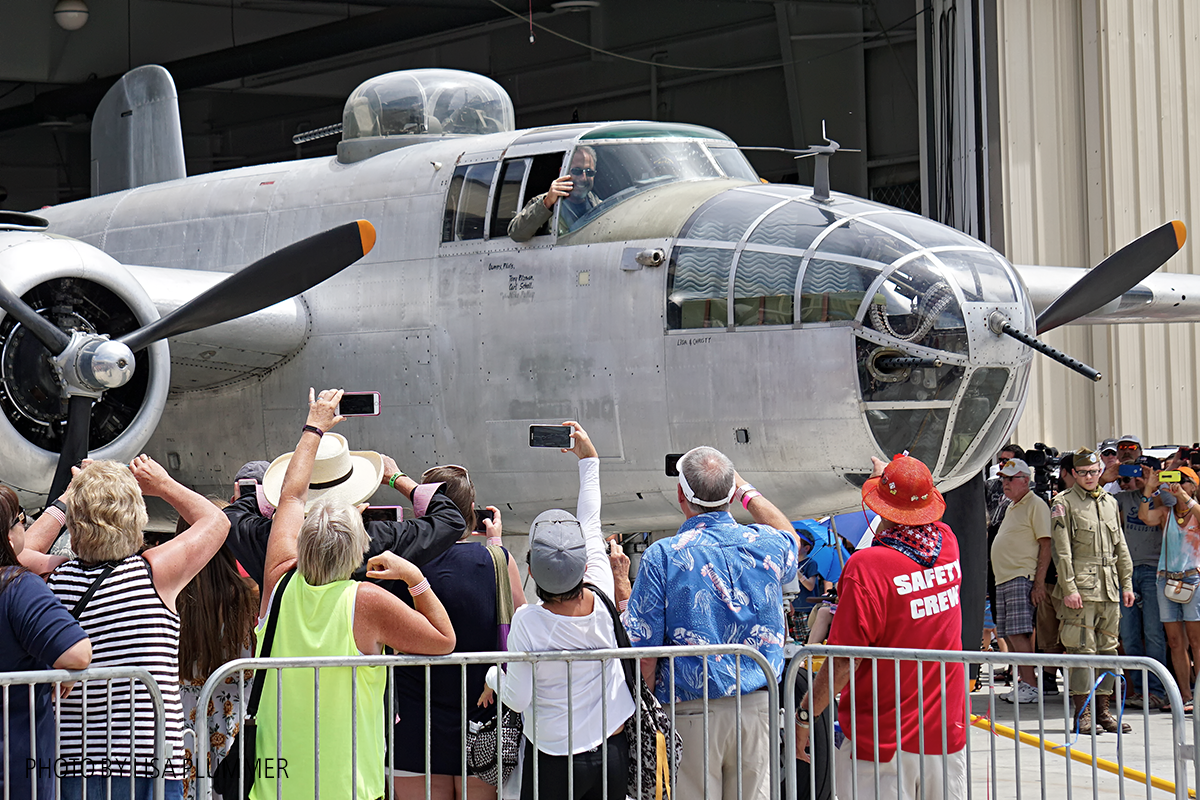 Aero Trader own B-25 piloted by Carl Scholl roll out for flower drop. (photo by Lisa Plummer)