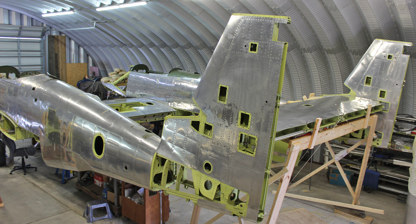 Offering up the rear fuselage/tail section to the main fuselages for final alignment and fitting. (photo via Tom Reilly)